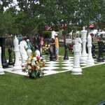 Kids playing wwith HUGE chess game