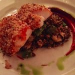 Cod wrapped in prosciutto on a bed of quinoa pilaf with lobster and beet puree