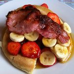 Buttermilk pancake, banana, strawberry, maple syrup with bacon. As good as it sounds and looks!