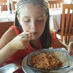 Mia enjoying her pasta meal.