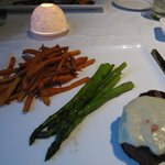 A filet with sweet potato fries
