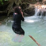 Jumping into the cool clear water