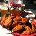 Hot Baked Wings with Molson Canadian in a Coors pitcher