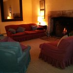 Lounge area with lovely log fire and view over the garden