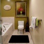 Ensuite bathroom with soaker tub and rainhead shower.