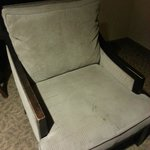 "This was the chair that we moved into the ""deluxe"" room, which had no place to sit.  Gross."