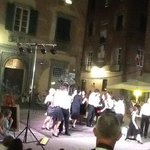 Americans singing Puccini beside his statue on hot summer night in Lucca
