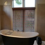 Bathtub, sink and lots of natural light