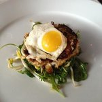 crab cake over arugula with quail egg in top