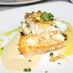 Halibut, this is how it was served, broken up and thrown on top of each other. Sloppy.