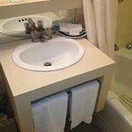 very basic vanity and tub/shower