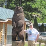 Standing next to carved bear at lodge