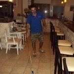 nikos cleaning floor
