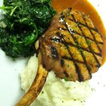 Prime pork chop with sautéed spinach, mashed potatoes, & chipotle Demi-glacé.