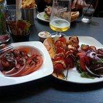 Chicken skewers and tomato side salad