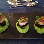 Scallops on black pudding with pea puree