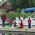 the kids fishing with grandpa and dad