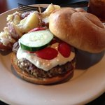 Greek burger. Feta and olives mixed in the patty and tzatziki sauce as dressing.