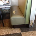 ripped seat in booth