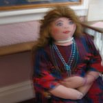 blurry pic of the scary stuffed lady at the top of the stairs