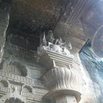 Carvings of Shankara Parvati near the ceiling of the main cave