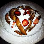 Stuffed cream cheese strawberry whipcream French toast