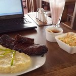 Ribs entree with mashed potatoes and cole slaw