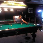 One of the many who enjoy the great food and a game or two of pool on one of the beautiful table