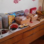 Typical breakfast selection - cereals, breads, pastries, berries, butter, jams