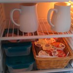 Typical chilled breakfast selection - fruit juice, milk, cheese, ham, yoghurts