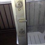Broken handle on patio door with screws uncovered.