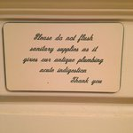 cute sign in the bathroom