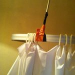 tape holding shower curtain up