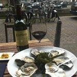 Sitting on the terrace enjoying amazing oysters with a chutney of mango
