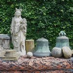 Old statues, bells and stones in the courtyard