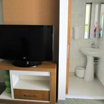 TV and sink in second adjoining bathroom