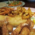 Fisherman's Delight (Breaded shrimp, scallops and fish with fries, coleslaw and tartar sauce.)