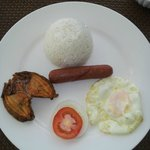 Delicious breakfast - 2 freshly cooked pieces of danggit with egg, sausage and rice.