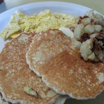 pancakes, scrambled eggs and home fries