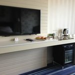 Modern Flat Screen TV with selectively free mini bar underneath