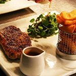 Hand cut steaks served with peppercorn sauce and a side