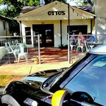 Otto's entrance and patio dining area