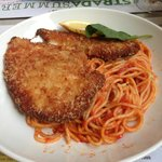 Pollo Milanese, breaded chicken breast on spaghetti