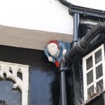Quirky man peeping from the eaves....