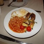 Homemade vegetarian tofu & chestnur sausages, free range duck egg, beans, tomatoes, tatties & mu