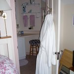 Private en-suite bathroom with terry cloth robes