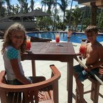 Kids enjoying a welcome drink beside the pool