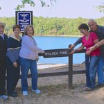 Friends enjoying a day of serene nature at historic Walden Pond