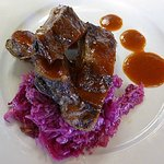 Mini Baby Back Ribs seared with BBQ sauce and topped with cabbage slaw.