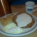 Tasty country-fried steak w/milk gravy, hashbrowns, eggs